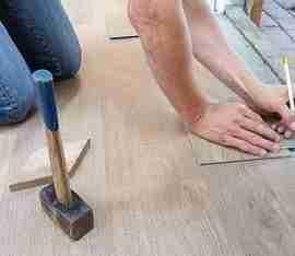 Men renovating floor